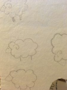 First I sketched out the basic shape on bead backing.